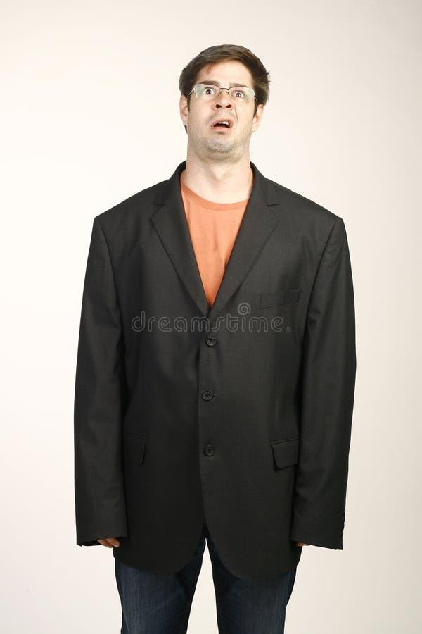 Mann in der sackartigen Klage lizenzfreie stockfotografie