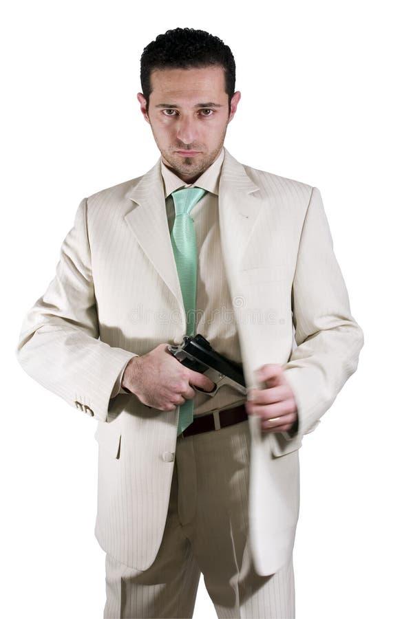 Mann, der seine Gewehr auszieht stockbilder