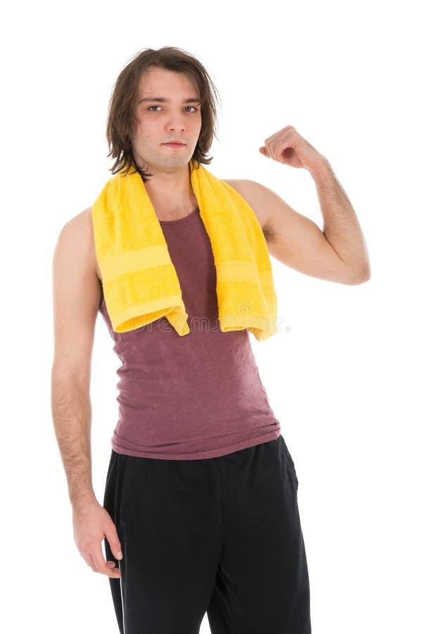 Mann in der Sportkleidung, die seine Muskeln, lokalisiert auf Weiß zeigt lizenzfreie stockbilder