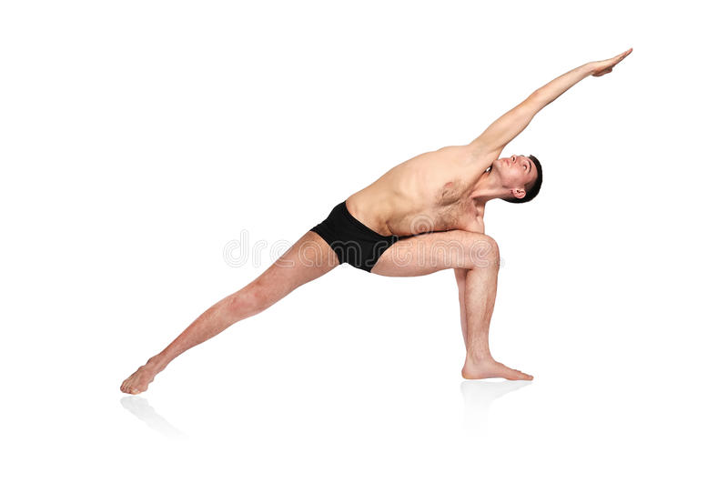 Mann, der Yoga tut stockfotografie