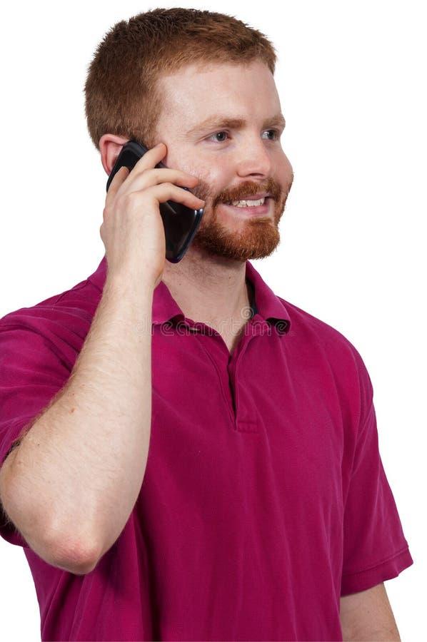 Mann an einem Handy lizenzfreie stockbilder