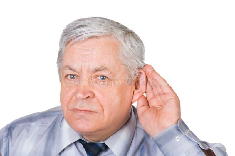 Mann in hörender Haltung stockbild