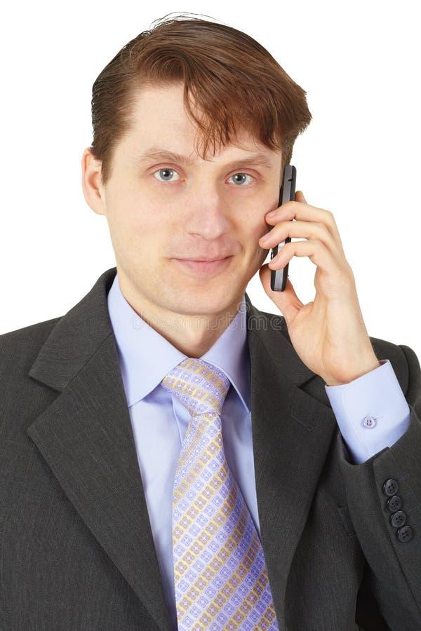 Mann im Anzug sprechend am Telefon lizenzfreies stockbild