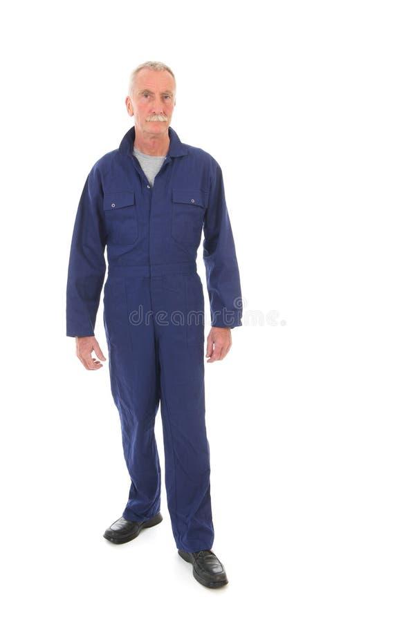Mann im blauen Gesamten stockfotos