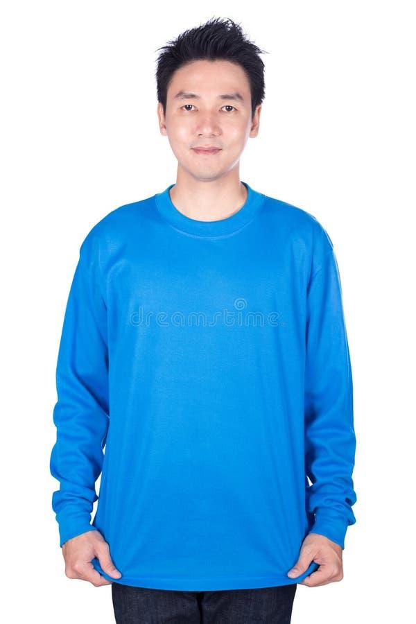 Mann im blauen langärmligen T-Shirt lokalisiert auf einem weißen Hintergrund stockfotos