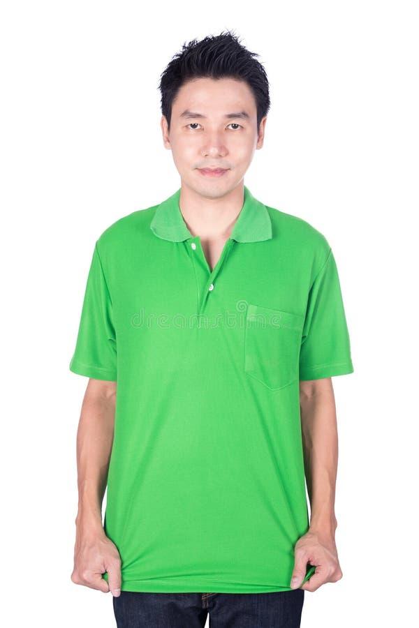 Mann im grünen Polohemd lokalisiert auf weißem Hintergrund lizenzfreie stockfotos