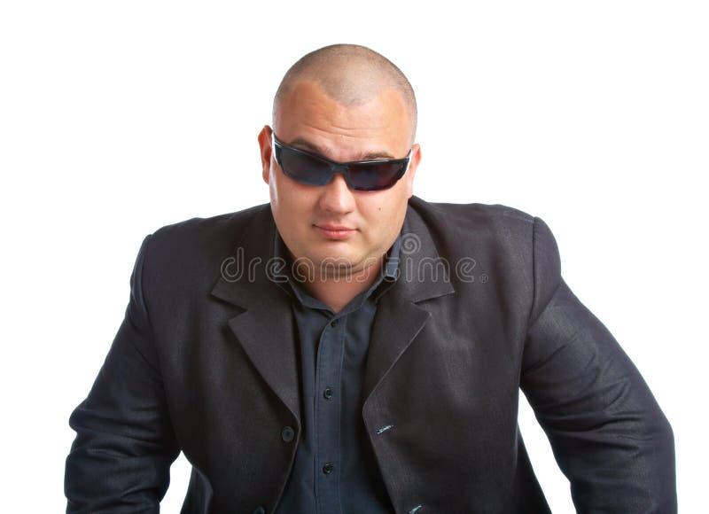 Mann im Schwarzen stockfotografie