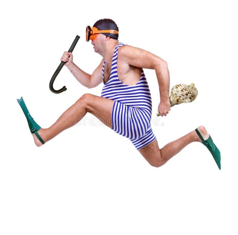 Mann im Schwimmenkleiderbetrieb stockfotos