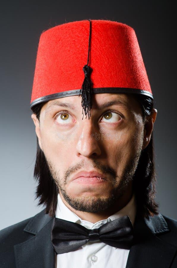 Mann im traditionellen türkischen Hut stockbilder