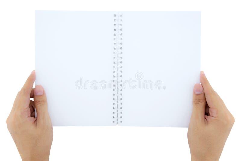 Mann (Mann) zwei Hände halten ein leeres (leeres) Buch (Anmerkung, Tagebuch) spre lizenzfreies stockbild
