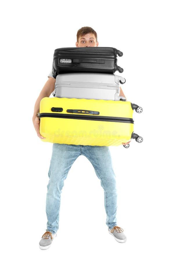 Mann mit überladenem Gepäck stockfotos