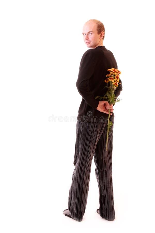 Mann mit Blumen stockbild