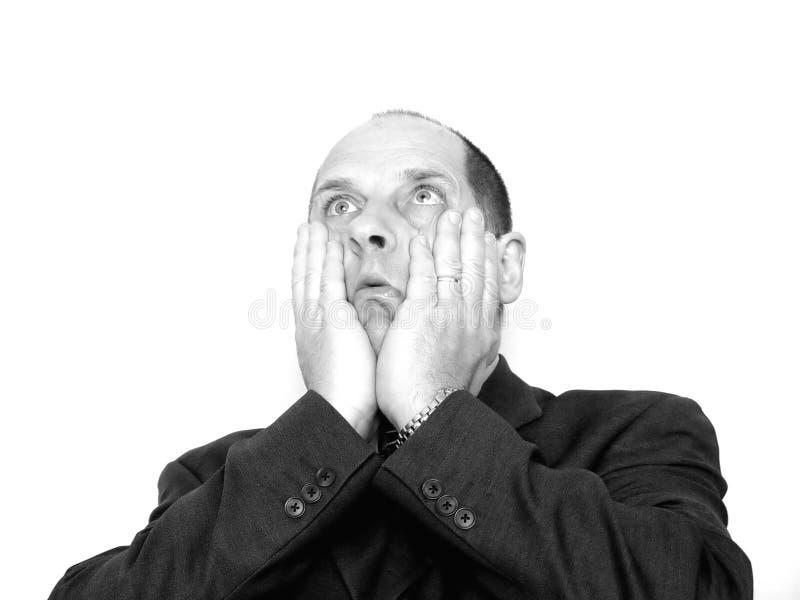 Mann mit den Händen auf Gesicht lizenzfreies stockbild