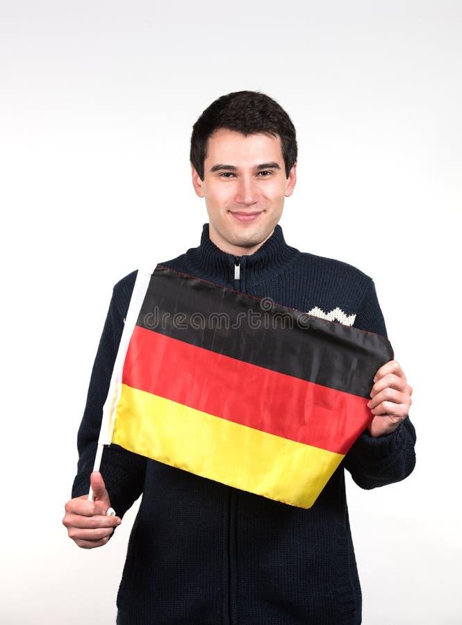 Mann mit deutscher Flagge lizenzfreie stockfotografie
