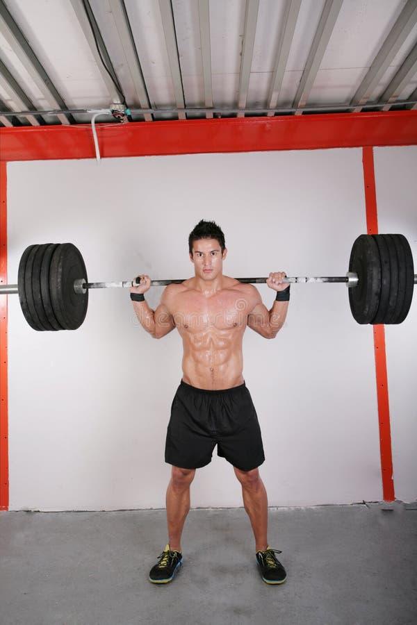 Mann mit Dumbbellgewicht lizenzfreie stockfotos