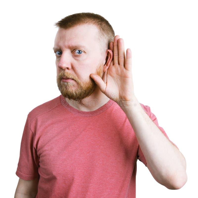 Mann mit einem Bart hört auf etwas lizenzfreie stockbilder