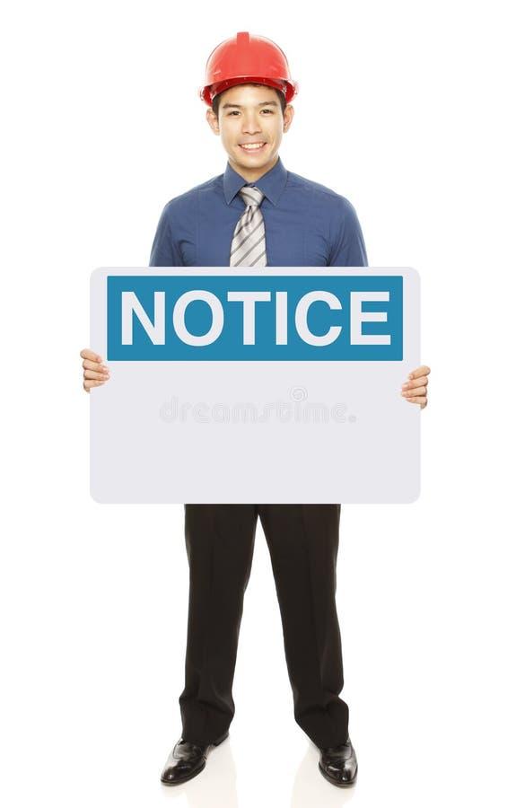 Mann mit einem Begriffs-Zeichen stockbild