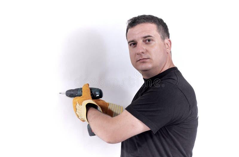 Mann mit einer Bohrgerätmaschine lizenzfreies stockfoto