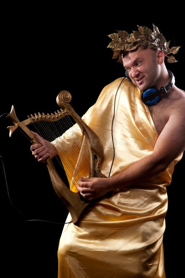 Mann mit einer Harfe stockfotografie