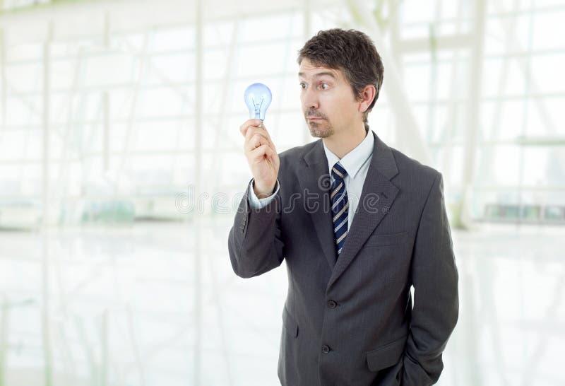 Mann mit einer Lampe lizenzfreie stockfotos