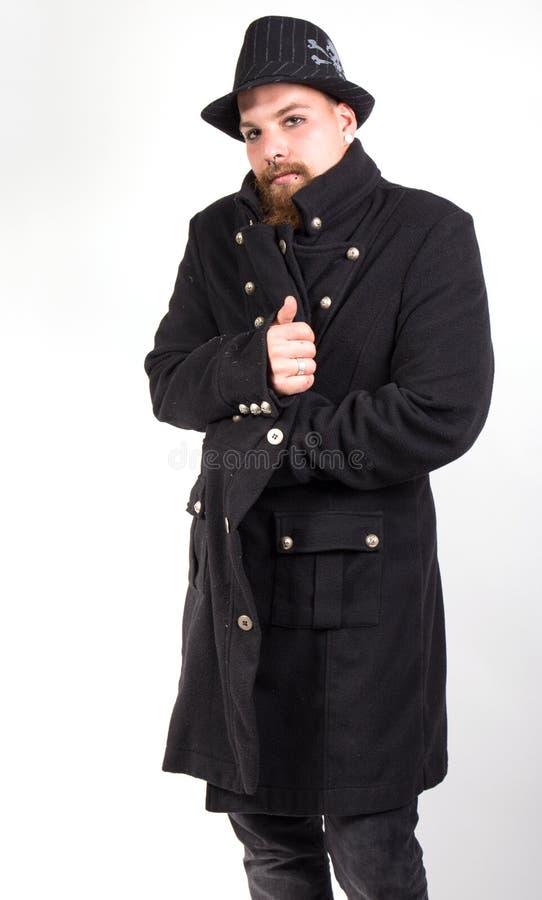 Mann mit elegantem Mantel stockbilder