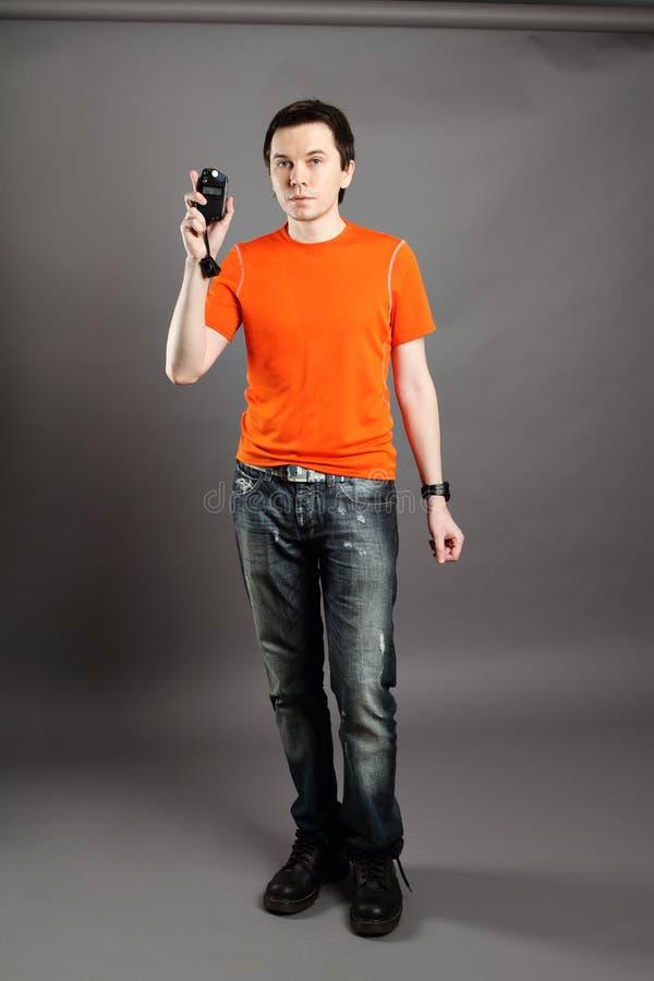 Download Mann mit flashmeter. stockbild. Bild von stattlich, person - 26371725