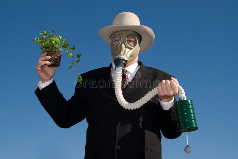 Mann mit Gasmaske u. Anlage. stockfotos