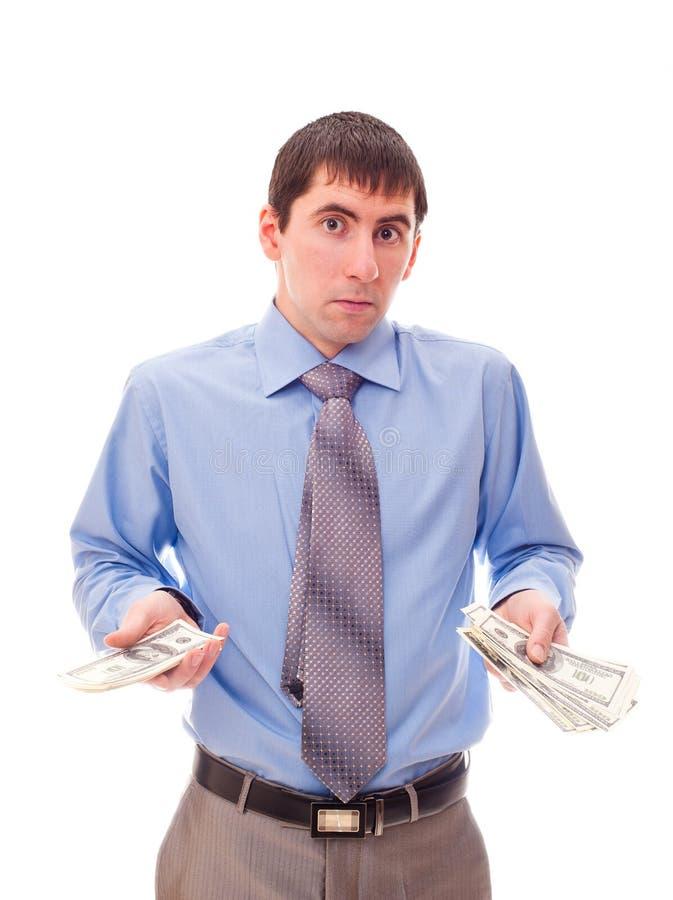 Mann mit Geld in seiner Hand stockfotos