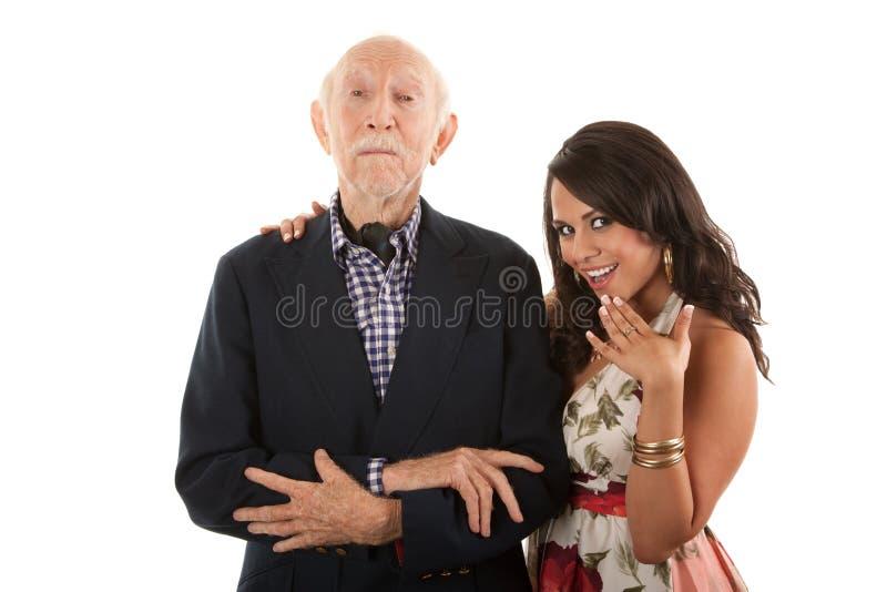 Mann mit Goldgräber Begleiter oder Frau lizenzfreie stockfotos