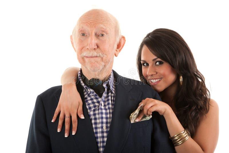 Mann mit Goldgräber Begleiter oder Frau lizenzfreies stockfoto