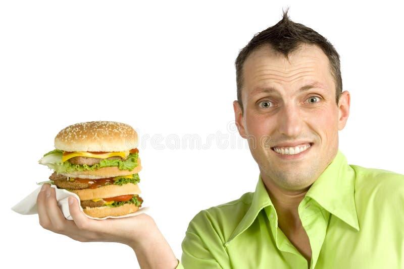 Mann mit Hamburger stockbild