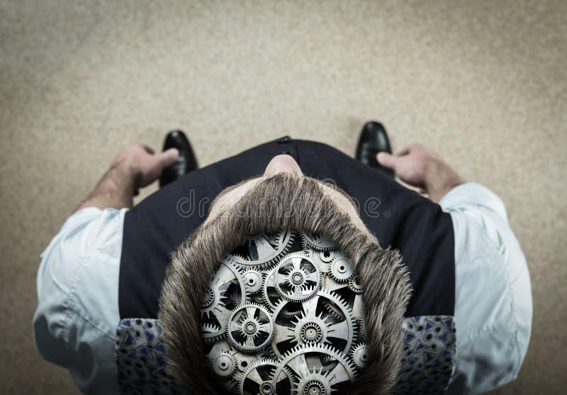 Mann mit Lager in seinem Gehirn lizenzfreie stockfotografie