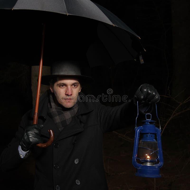 Mann mit lampion stockbilder
