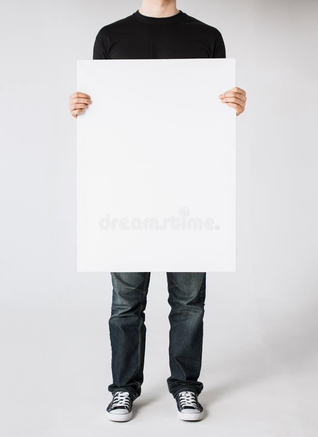 Mann mit leerem weißem Brett lizenzfreie stockfotografie
