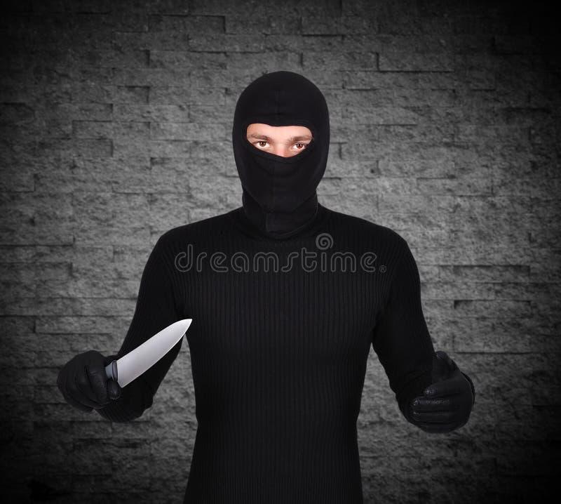 Mann mit Messer stockfoto