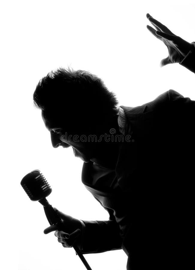 Mann mit Mikrofon stockfotos