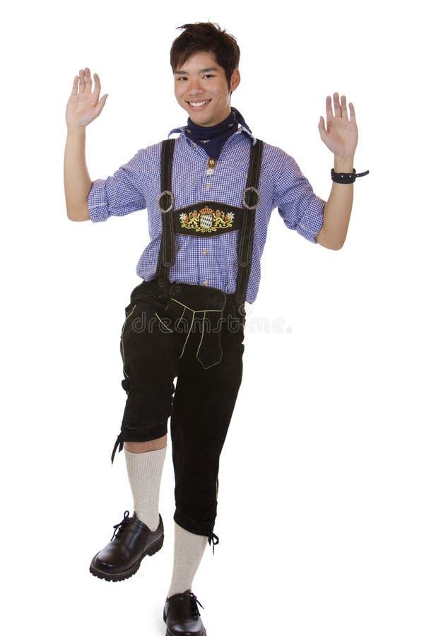 Mann mit Oktoberfest lederner Hose tut stockbilder
