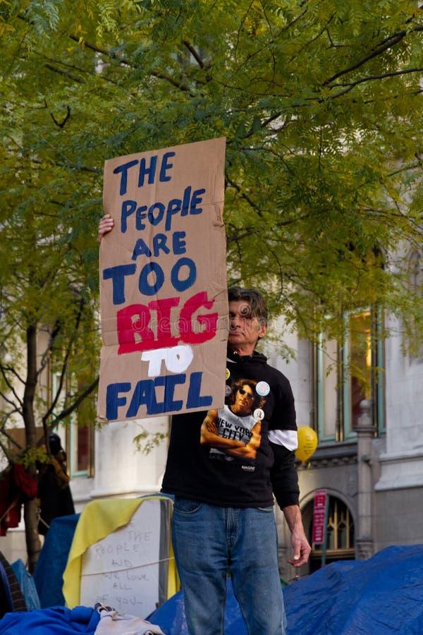 Mann mit Protestzeichen bei Occupy Wall Street stockbild
