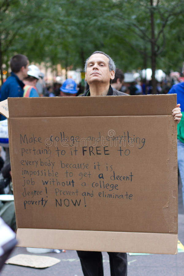 Mann mit Protestzeichen bei Occupy Wall Street stockfoto