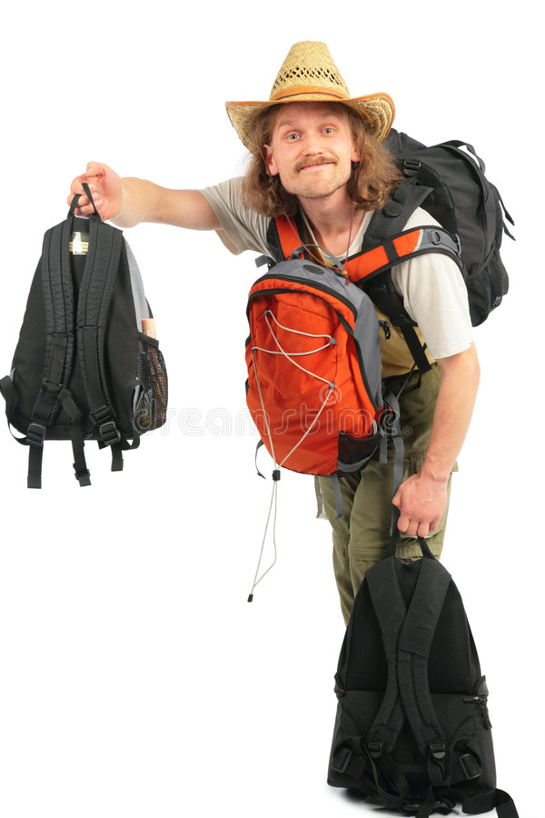 Mann mit Rucksäcken im Strohhut lizenzfreies stockbild