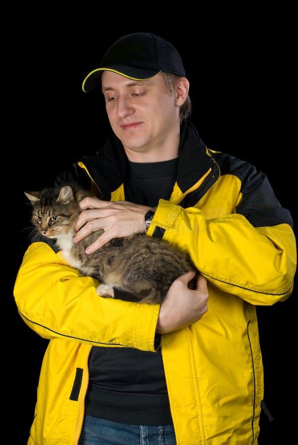 Mann mit seiner geliebten Katze stockfoto