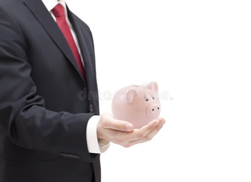 Mann mit Sparschwein in der Hand stockfotografie