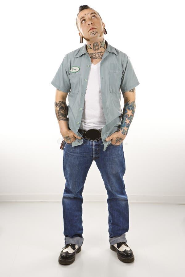Mann mit Tätowierungen lizenzfreie stockbilder