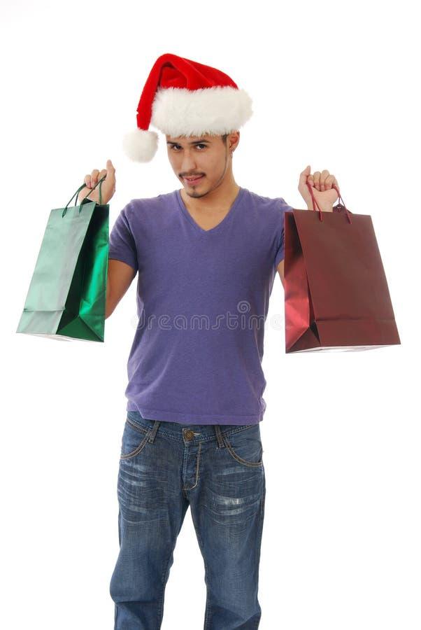 Mann mit Weihnachtsgeschenken stockbilder