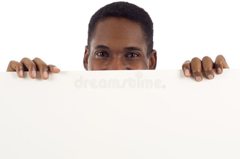 Mann mit Zeichen stockbild