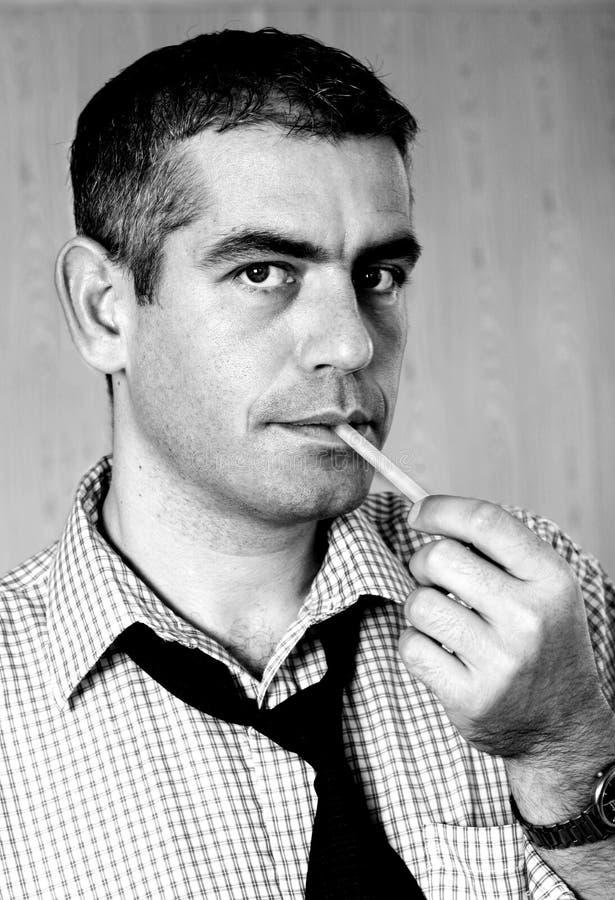 Download Mann mit Zigarette stockbild. Bild von portrait, schauen - 34371