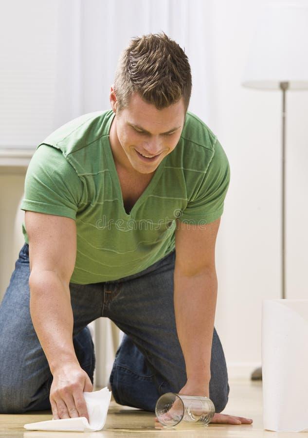 Mann-Reinigungs-Streuung stockbild