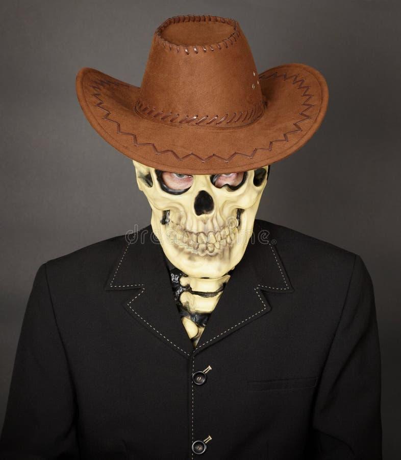 Mann - Skelett im ledernen Cowboyhut lizenzfreie stockfotografie