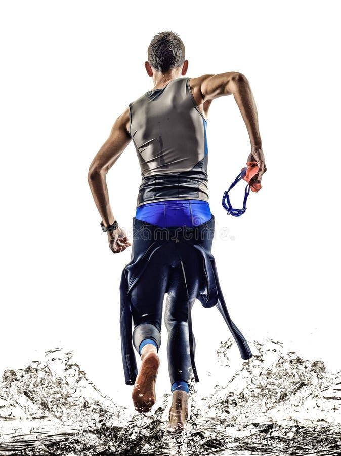 Mann Triathloneisenmannathletenschwimmerlaufen stockfotos