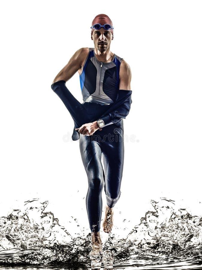 Mann Triathloneisenmannathletenschwimmerlaufen lizenzfreies stockfoto